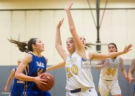 Falmouth senior Abby Ryan tries to block Lake Region junior Chandler...  News Photo - Getty Images