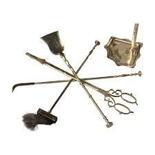 set of bronze and brass fireplace tools