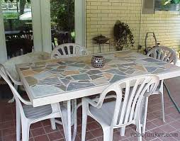 broken glass top table with a mosaic