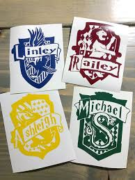 Personalized Name Hogwarts House Crest Vinyl Decal Gryffindor Hufflepuff Ravenclaw Slytherin Har Hogwarts Houses Crests Harry Potter Gifts Personalized Decals