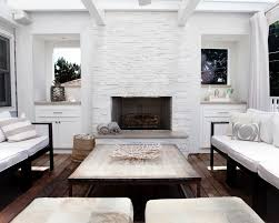 a white painted stone fireplace serves