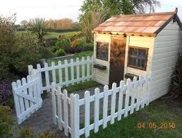 Playhouse With Picket Fence Outdoor Yard Ideas Backyard Play Area Backyard