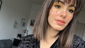 yellow eye makeup flower freckles