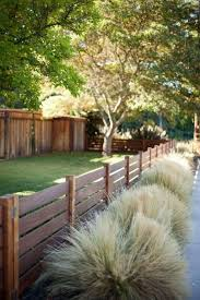 55 Awesome Fence Ideas For Back Yard And Front Yard Privacy Fence Landscaping Backyard Fences Fence Landscaping