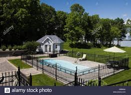 In Ground Pool Surrounded Black Wrought Iron Fence In Landscaped Residential Backyard In Summer Quebec Canada This Image Stock Photo Alamy