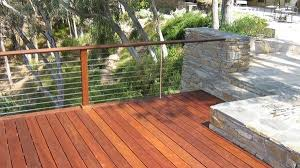 deck with cable railing and stone patio