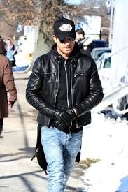 men wearing leather gloves photo
