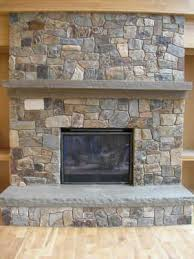 stone wall with woodstove and bluestone