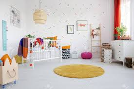 Orange Round Rug And Posters In Colorful Kid S Room Interior Stock Photo Picture And Royalty Free Image Image 109343962