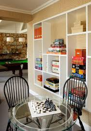 Kid Picks Game Traditional Family Room And Built In Shelves Custom Shelves Game Room Interior Wallpaper Lucite Table Pendant Lighting Pool Table Stone Wall White Baseboards Windsor Chairs Finefurnished Com