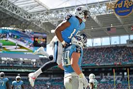 Tennessee Titans wide receiver Rishard Matthews (18) celebrates the  touchdown of Tennessee Titans tight end Phillip Supernaw (89) during the  second half against the Miami Dolphins at Hard Rock Stadium. (Jasen  Vinlove-USA