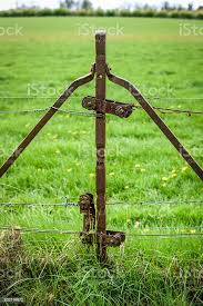 Rusty Fence Post With Tensioner Stock Photo Download Image Now Istock