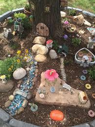 miniature fairy garden under a tree