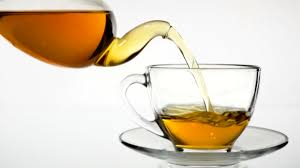 pouring tea being poured into glass