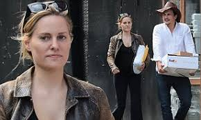 Rupert Friend and Aimee Mullins look loved-up as they run errands ...