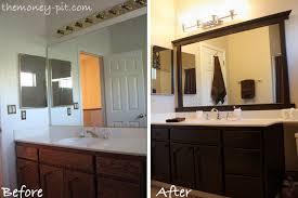 adding a frame to a bathroom mirror