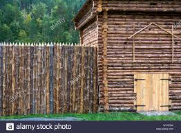 New Log House With A Decorative Fence Of Pointed Wooden Poles Stock Photo Alamy