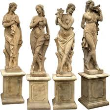 four garden statues with bases four