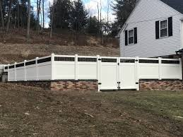 What A Show Stopper This Fence Is Solid White Vinyl Privacy Fence With A Closed Spindle Topper In Black Built On In 2020 Vinyl Privacy Fence White Fence Vinyl Fence