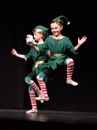 Santa's elves, Lillian Conry and Addie Miller, perform. (Paula ...