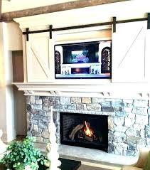 tv on wall above fire kutech me