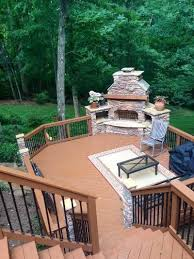 trex deck with outdoor fireplace