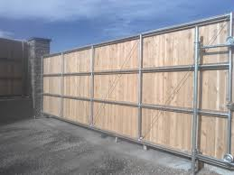 Inside View Of Wood To Steel Rolling Gate Residential Industrial Fencing Company In Denver Co
