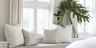 pairing shutters with curtains