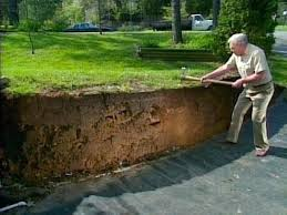 wood retaining wall on a slope