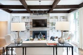 plank fireplace flanked by white built