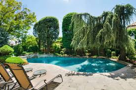 an in ground backyard pool in nyc pipe