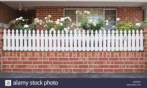 Beautiful House Entrance With White Fence And Small Front Yard Stock Photo Alamy