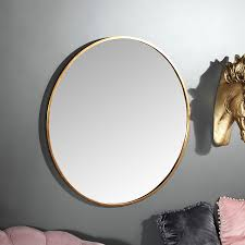 large round gold framed wall mirror