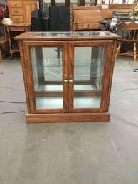 small lighted curio cabinet hall