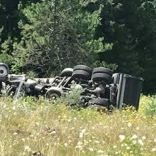 Dump truck crash sends woman to hospital