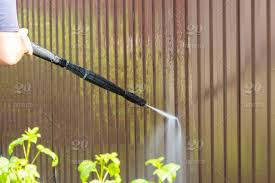 Cleaning Fence With High Pressure Power Washer Cleaning Dirty Wall Stock Photo 4f5a2bcd 9b50 4b32 9ff5 B9270adac914
