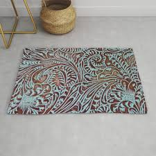 light blue brown tooled leather rug