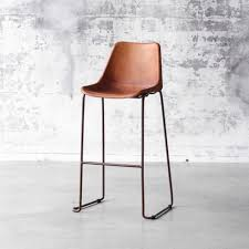 bar stool in iron with rust finish and