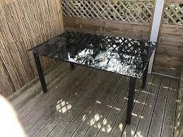black glass top garden patio table
