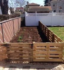 10 Impressive Pallet Fence Ideas Anyone Can Build