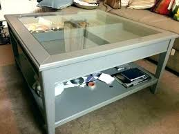 glass top display coffee table with