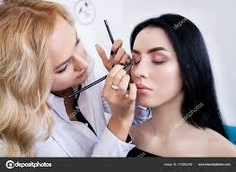 artist preparing beautiful bride