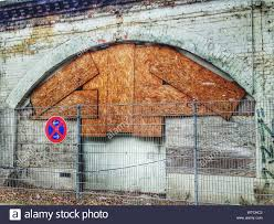 Fence Against Arch Brick Wall Covered With Wooden Planks Stock Photo Alamy