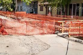 Construction Site Orange Safety Net Fence As Barrier Over The Trench On The Street Excavation For New District Heating Pipeline Reconstruction And Replacement Stock Photo Download Image Now Istock