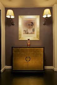 gold entry table for eclectic hall also