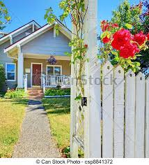 Small House And White Fence With Roses Small American House And White Fece With Red Roses