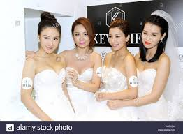 """From left) Hong Kong actresses Selena Li, Paisley Wu, Mandy Wong and Myolie  Wu pose at the opening ceremony for Myolie Wu's """"Kevolie"""" wedding dress s  Stock Photo - Alamy"""