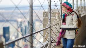 Happy Young Woman Tourist At The Observation Deck Of Empire State Building In New York City Female Traveler Enjoying The View Of Nyc Skyline Buy This Stock Photo And Explore Similar