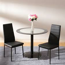 black glass dining table and 2 chair
