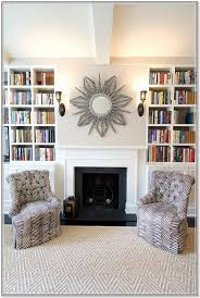 oval mirror over fireplace home